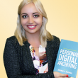 Brianna Marshall holding her book, The Complete Guide to Personal Digital Archiving