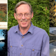 Professor Emeritus Ronald H. Chilcote pictured with four of his photography books