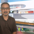 Michael Yonezawa pictured with conceptual drawings of the new library for the City of Riverside