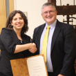 Tikva Hecht receives first place in the 2015 Petko Competition graduate division from University Librarian Steven Mandeville-Gamble