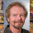 Michael Whelan and several of the Eaton Collection books with his cover art
