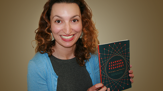 Dani Brecher Cook with a copy of her recently published book