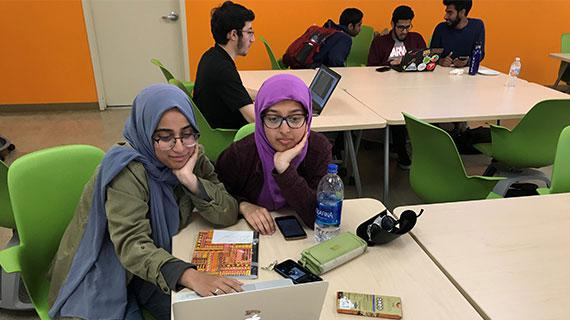 UC Riverside students help library staff to identify and describe Arabic leaves at Hivemind event