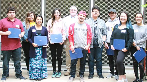 Class of 2018 library student employees with University Librarian Steven Mandeville-Gamble