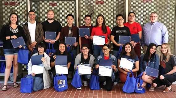 Class of 2019 UCR Library student employees pictured with University Librarian, Steven Mandeville-Gamble